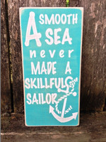 A smooth sea never made a skillful sailor sign