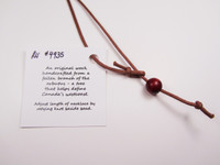 Necklace wood bead. Try also replacing with your own silver chain. It will look beautiful!