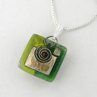 green snail charm