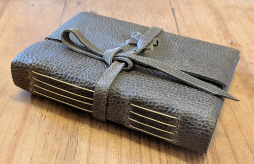 Side view of Spellbinding Journals - small grey tan