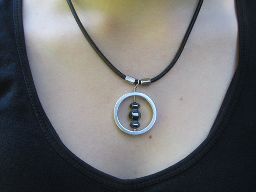 model with infinite creation pendant with hematite stone