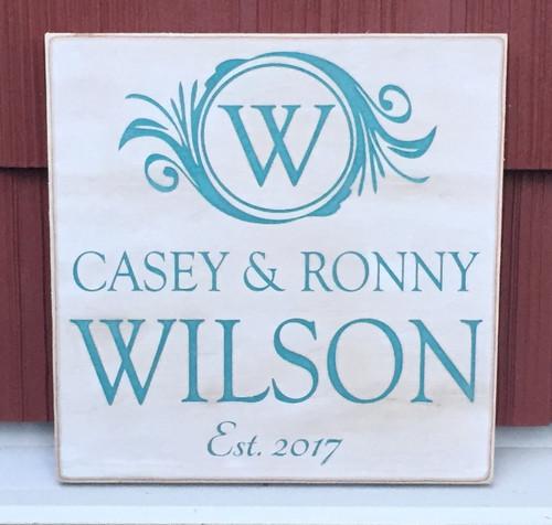 family establishment wood sign with monogram