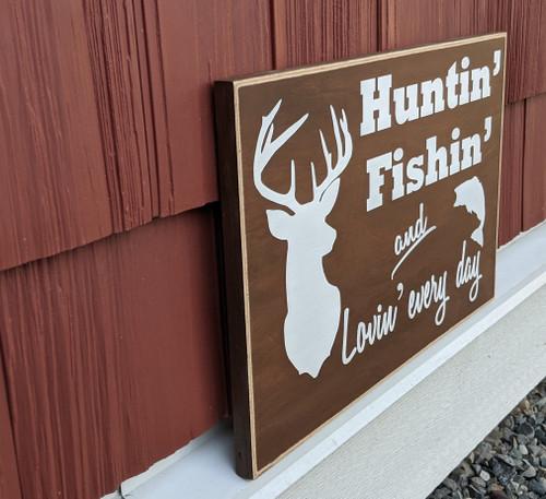 Huntin'Fishin'and lovin'every day - wood sign