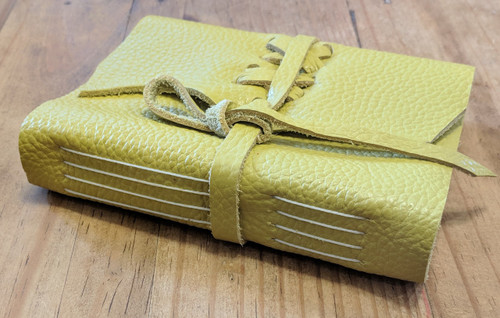 Side view of Spellbinding Journals - small yellow