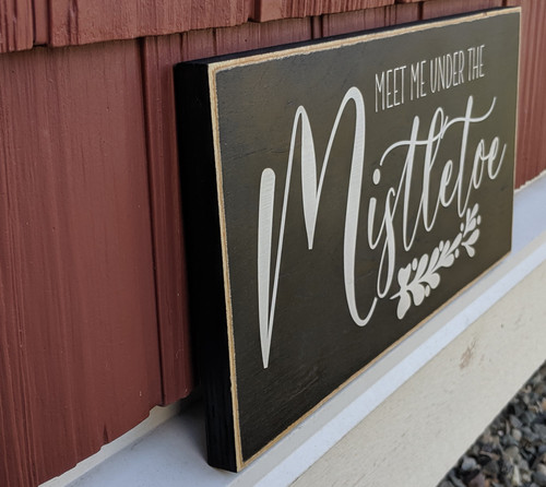 Meet me under the mistletoe sign side view