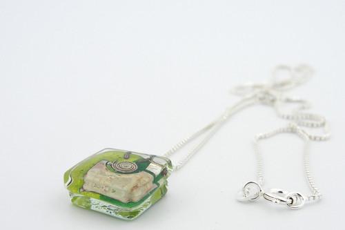 green snail charm pendant