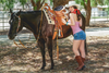 Pin-Up Cowgirl Standing By Horse Poster