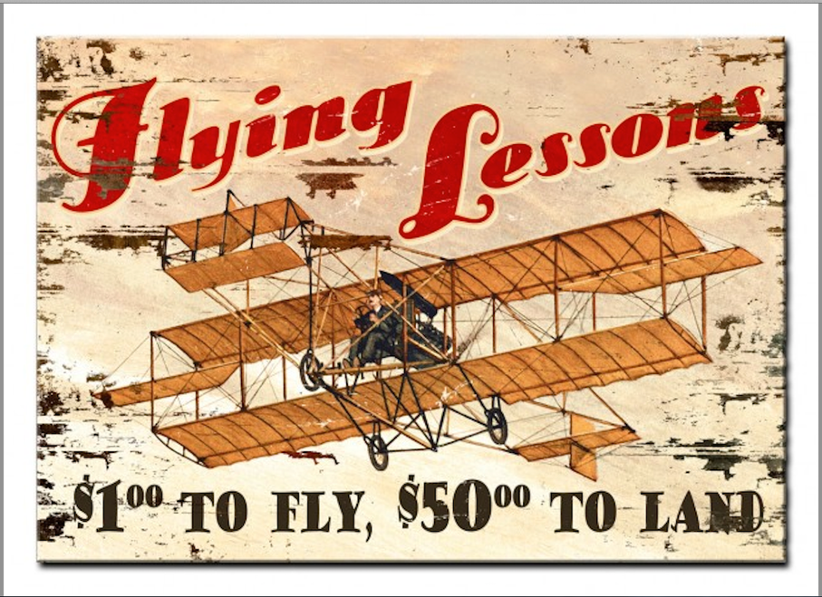 """FLYING LESSONS""  PRINTED ON A WOODEN SIGN"