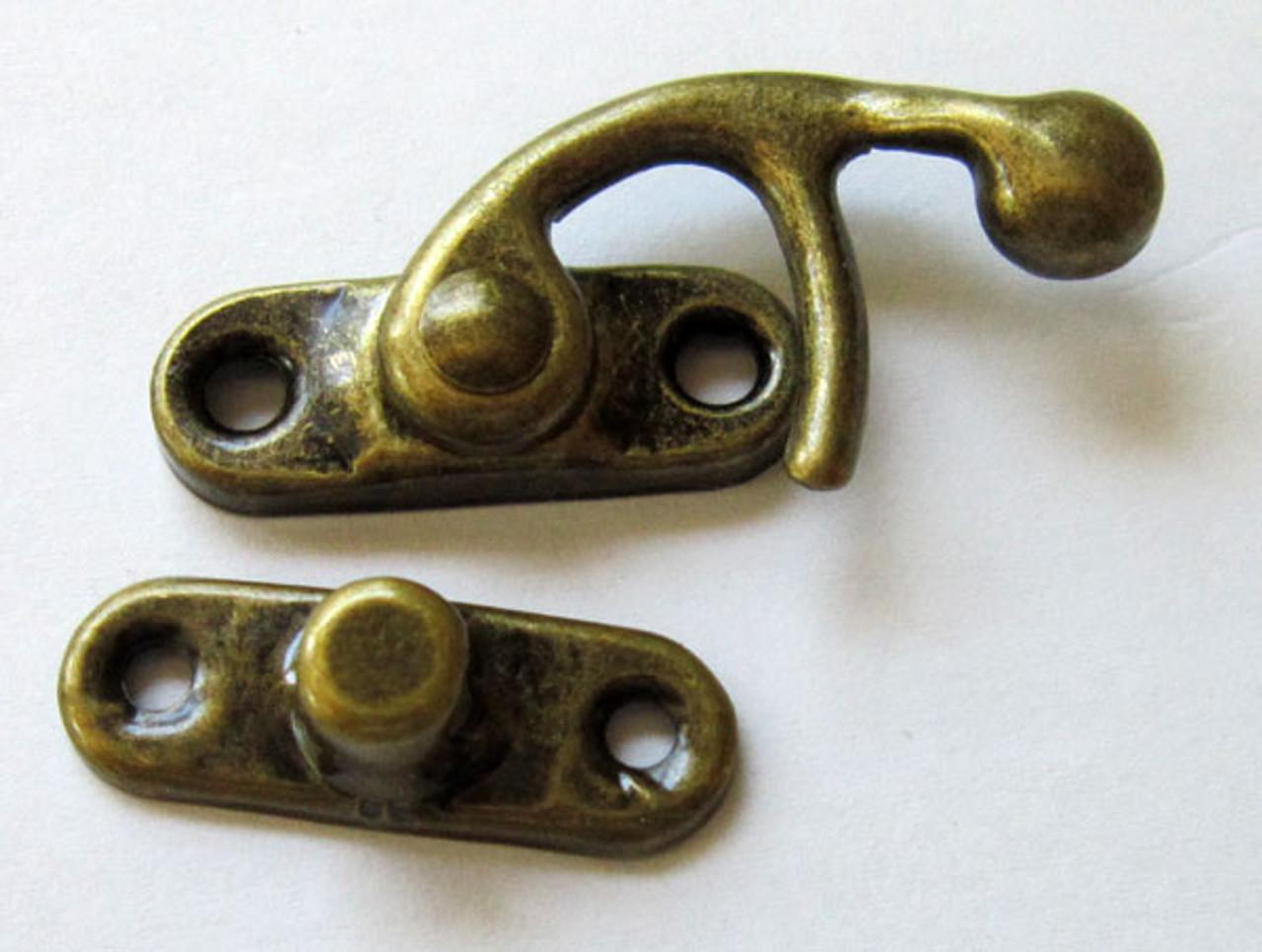 Swing arm latch antique brass