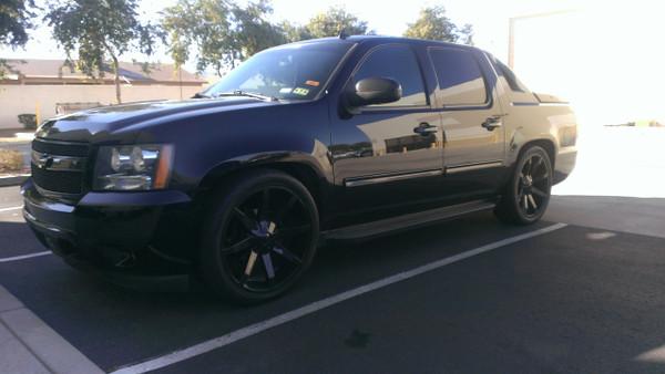 "2007 Chevrolet Avalanche - 3/5 McGaughys Deluxe Drop Kit, 24"" KMC Slide Wheels, 295/35R24 Tires"