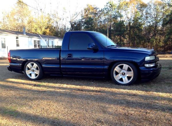 "1999 Chevrolet Silverado - McGaughys 5/7 Deluxe Drop Kit With 1"" Lowering Shackles, 20"" Factory Wheels, 255/45R20 Tires"
