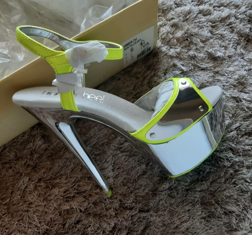 'Highest Heel' neon/chrome platforms