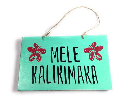 """Mele Kalikimaka"" Wooden Sign w/ plumeria design 8"" X 5""   #snd25125"