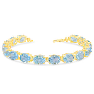 Oval Genuine Blue Topaz (9 x 7) Tennis Bracelet in Yellow Gold
