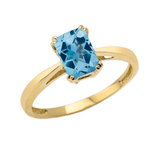 1 CT Emerald Cut Blue Topaz Solitaire Ring in Yellow Gold