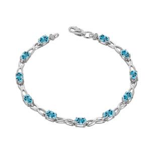 Blue Topaz  Infinity Bracelet in White Gold