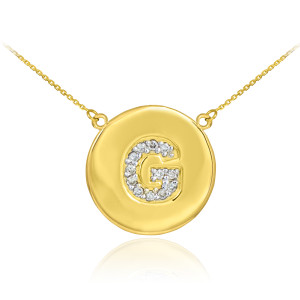 "14k Yellow Gold ""G"" Initial Diamond Disc Double-Mount Necklace.  12 diamonds total weight: 0.12 ct  Diamond clarity: SI1-2  Diamond color: G-H  14k Pendant weight: 1.5 grams  14k Double-mount necklace weight (including weight of pendant and depending on chain length) is approximately 2.5 grams."