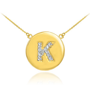 """14k Yellow Gold """"K"""" Initial Diamond Disc Double-Mount Necklace.  12 diamonds total weight: 0.15 ct  Diamond clarity: SI1-2  Diamond color: G-H  14k Pendant weight: 1.6 grams  14k Double-mount necklace weight (including weight of pendant and depending on chain length) is approximately 2.6 grams."""