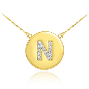 "14k Yellow Gold ""N"" Initial Diamond Disc Double-Mount Necklace.  14 diamonds total approximate weight: 0.14 ct  Diamond clarity: SI1-2  Diamond color: G-H  14k Pendant weight: 1.5 grams  14k Double-mount necklace weight (including weight of pendant and depending on chain length) is approximately 2.5 grams."