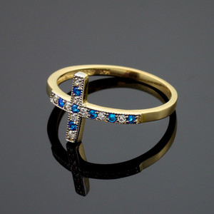Gold Sideways Cross Blue Zirconia Ring