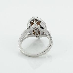 Marquise-shaped double halo diamond engagement ring in 14k white and rose gold.