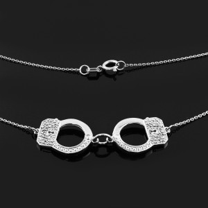Handcuffs necklace with diamond accents in 14k white gold.