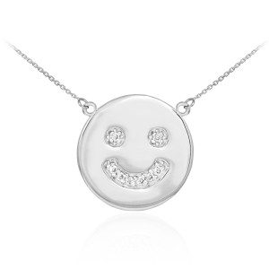 Smiley face disc necklace with diamonds in 14k white gold.