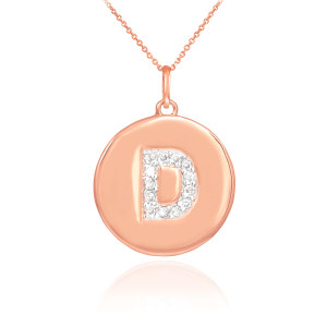 """Letter """"D"""" disc pendant necklace with diamonds in 14k rose gold."""