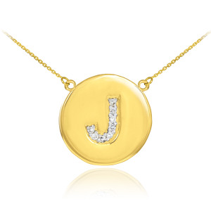 "Letter ""J"" disc necklace with diamonds in 14k yellow gold."