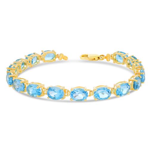 Oval Genuine Blue Topaz (8 x 6) Tennis Bracelet in Yellow Gold