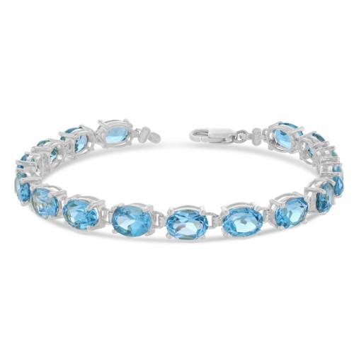 Oval Genuine Blue Topaz (8 x 6) Tennis Bracelet in Sterling Silver