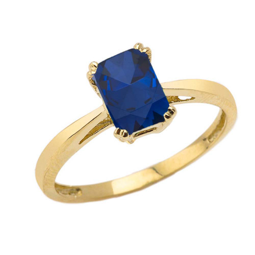 1 CT Emerald Cut Sapphire CZ Solitaire Ring in Yellow Gold