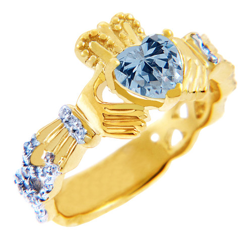 Gold Diamond Claddagh Ring with 0.40 Carats of Diamonds and an Aquamarine Birthstone.  Available in 14k and 10k Gold.