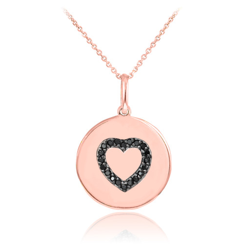 Heart disc pendant necklace with black diamonds in 14k rose gold.