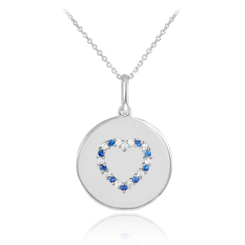 Heart disc pendant necklace with diamonds and sapphire in 14k white gold.