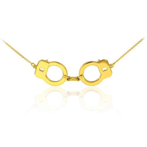 Handcuffs necklace in 14k yellow gold.