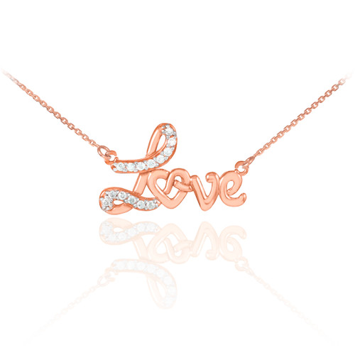 Love heart necklace with diamonds in 14k rose gold.