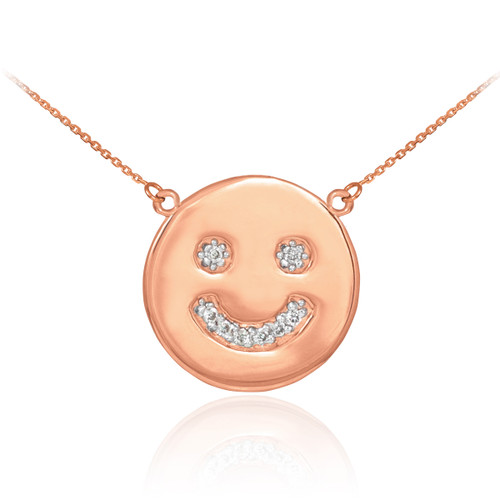 Smiley face disc necklace with diamonds in 14k rose gold.
