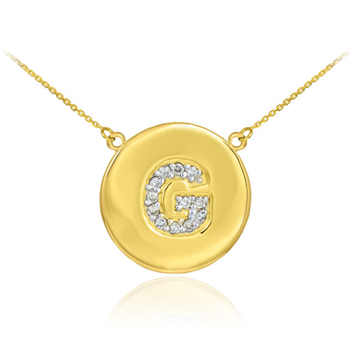 "Letter ""G"" disc necklace with diamonds in 14k yellow gold."