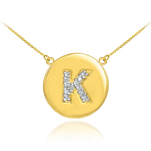 "Letter ""K"" disc necklace with diamonds in 14k yellow gold."
