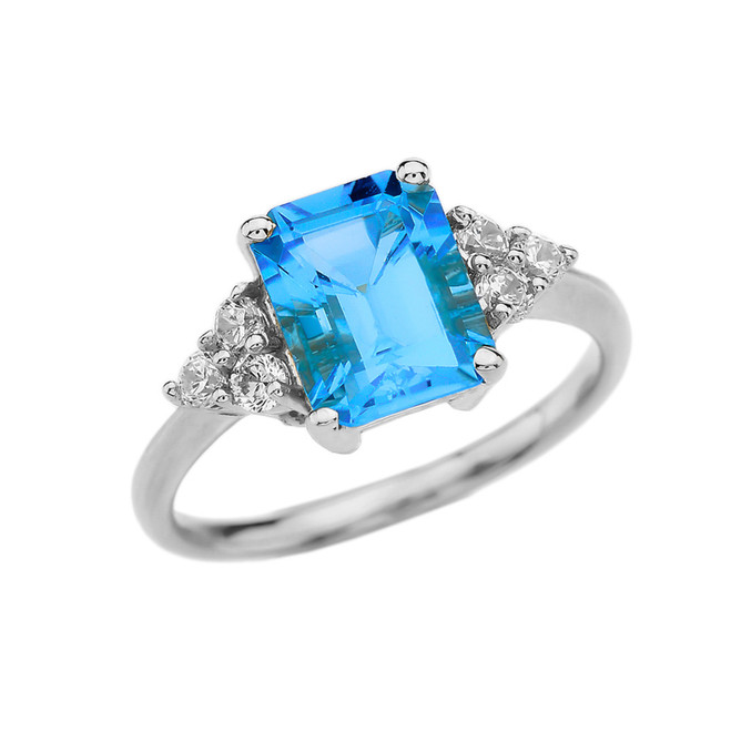2.5 Carat Blue Topaz Modern Proposal/Promise Ring With White Topaz Side-stones In White Gold