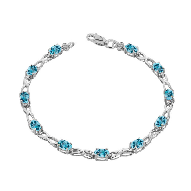 Blue Topaz  Infinity Bracelet in White Gold