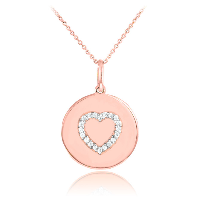 Heart disc pendant necklace with diamonds in 14k rose gold.