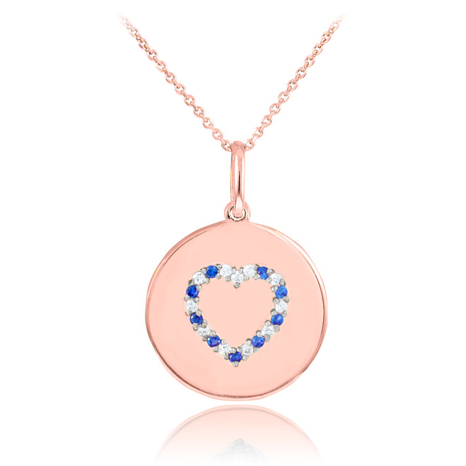 Heart disc pendant necklace with diamonds and sapphire in 14k rose gold.