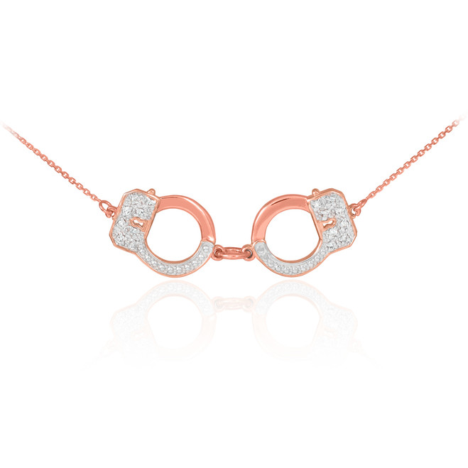 Handcuffs necklace with diamond accents in 14k rose gold.