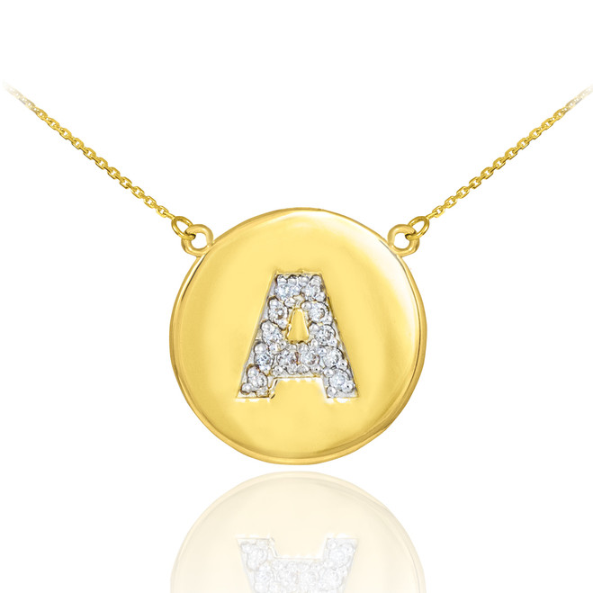 "Letter ""A"" disc necklace with diamonds in 14k yellow gold."