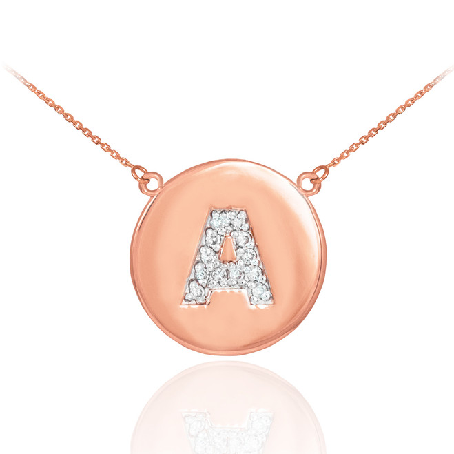 "Letter ""A"" disc necklace with diamonds in 14k rose gold."