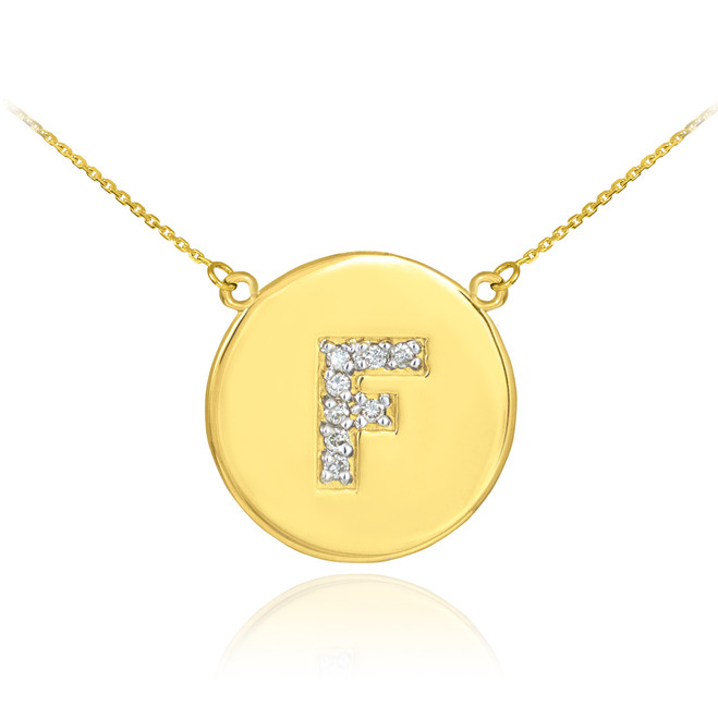"Letter ""F"" disc necklace with diamonds in 14k yellow gold."