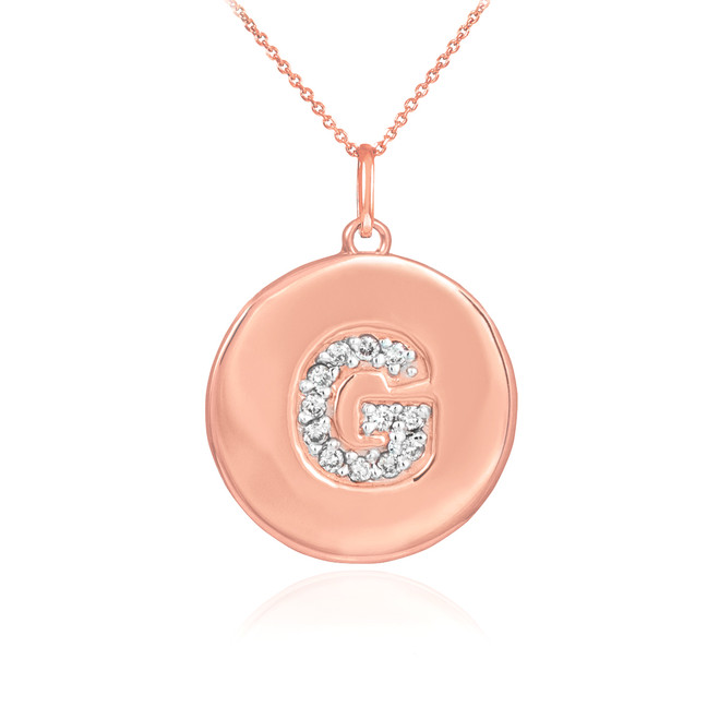 "Letter ""G"" disc pendant necklace with diamonds in 14k rose gold."