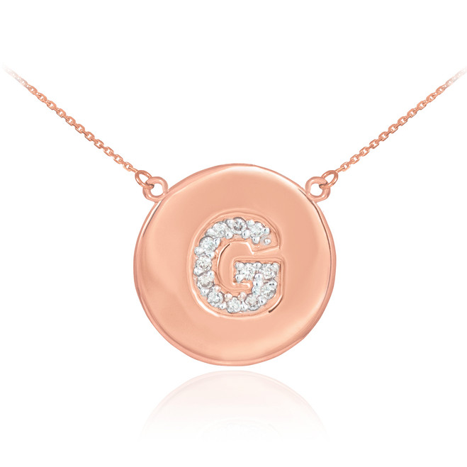 "Letter ""G"" disc necklace with diamonds in 14k rose gold."